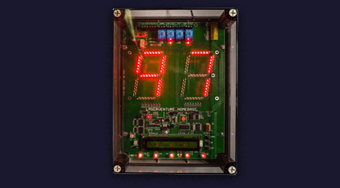 Wall-mounted scoreboard for laser game Capture the Flag, configured with AtriumPlus